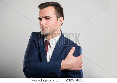 Attractive Business Man Holding Shoulder Like Hurting