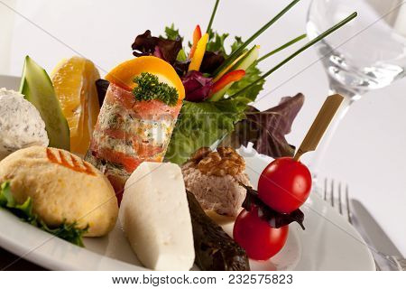 A Delicious Selection Of Cold Meats, Cheeses, Condiments, Fruit And Other Snacks On A Mezze Or Buffe