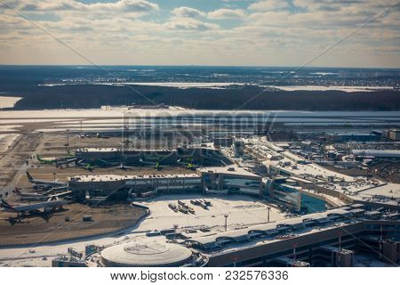 Moscow, Russia - March 16, 2018: Domodedovo airport aerial landscape at sunny winter day time