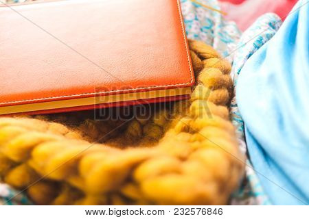 A Book And A Knitted Hat.