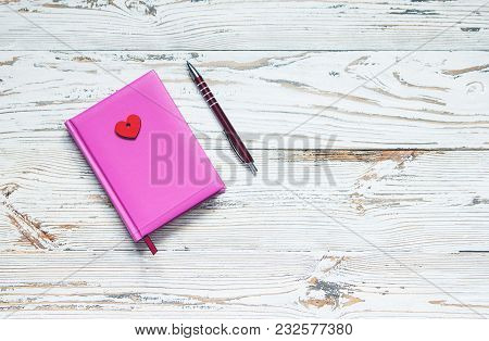 Pink Note Pad Decorated With Hearts On A White Wooden Vintage Background. Style Provence. Rustic Sty