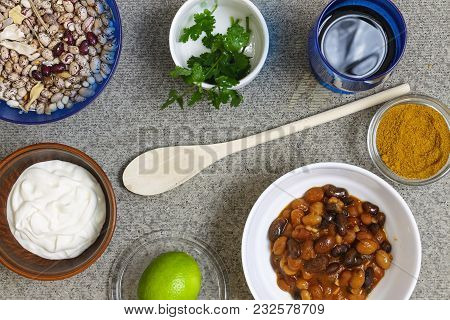 Ingredients Of American And Mexican Cuisine. Beans, Spices, Coriander, Wine, Sour Cream In Bowls On
