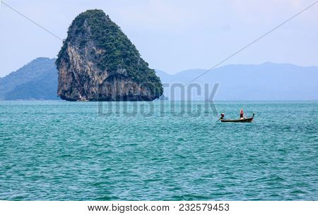 Alone Fishing And Boat In Phuket Thailand
