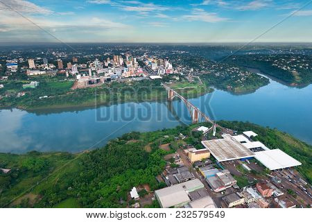 Aerial View Of The Paraguayan City Of Ciudad Del Este And Friendship Bridge, Connecting Paraguay And