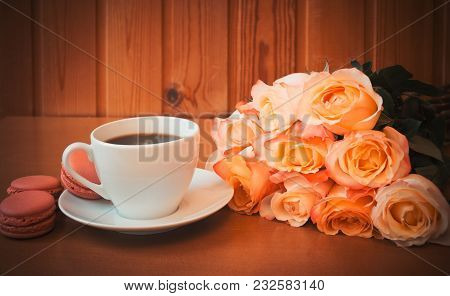 Cup Of Coffee With Bouquet Of Pink Roses Flowers. Selective Focus.