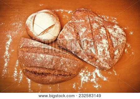 Different Types Of Rye Bread On Wooden Background