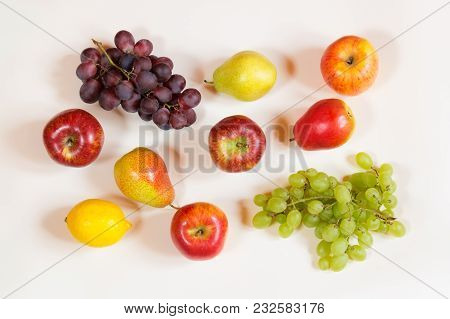 Colorful Food Pattern Made Of Apples, Pears, Lemon And Grape