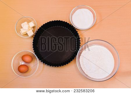 Flour, Eggs, Sugar, Butter And Form For Baking Cake. Top View.