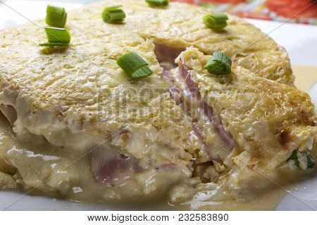 Baked Cake Made From Ham, Eggs, Cheese And Sour Cream On Plate