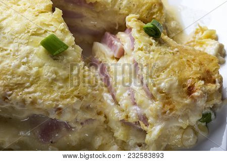 Close Up Of Baked Cake Made From Ham, Eggs, Cheese And Sour Cream On Plate