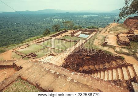 Scenic View Mountain City Sigiriya With Rural Landscape, Water Pool, Ruins And Trees, Sri Lanka. Une