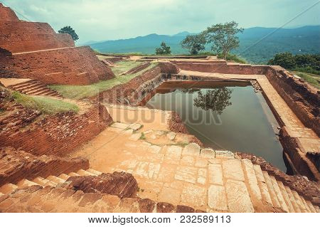 Landscape With Ancient Pond Of Sigiriya City, Ruins And Archeological Area In Sri Lanka. Unesco Worl