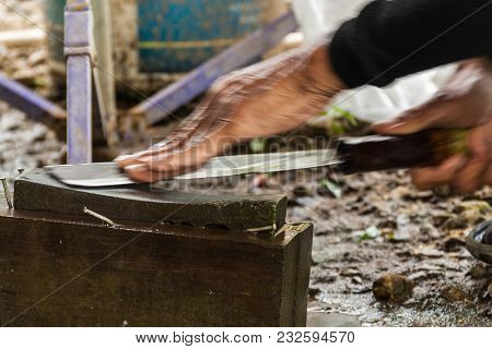 Knife Whetting, Thai Villager Is Whetting The Knife Before Cooking The Meal.