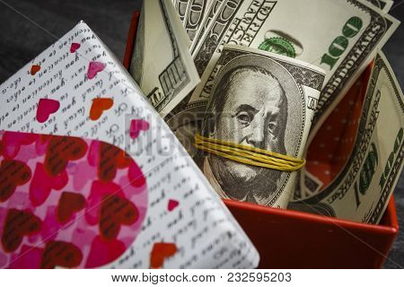 Pile Of Dollars In A Red Gift Box