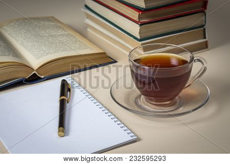 Tea, Books And Notebook On White Table