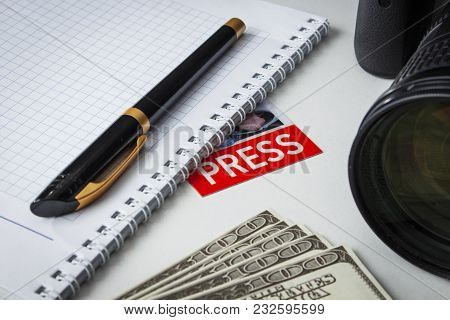 A Few Bills On The Desk Of A Journalist