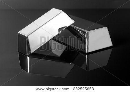 Silver Bullion Bars On A Black Background