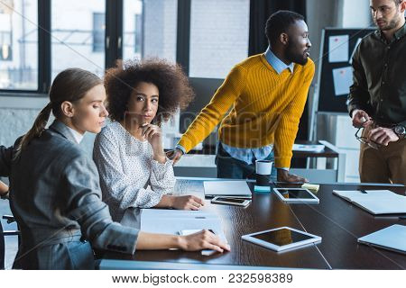 View Of Multiethnic Businesspeople During Meeting In Office