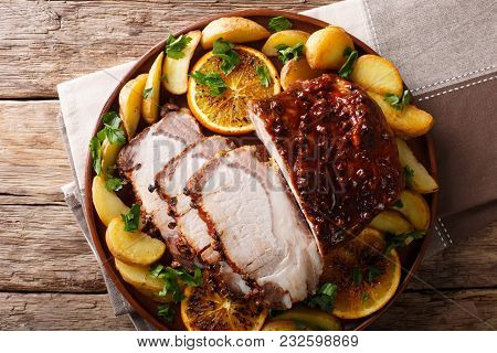 Spicy Pork Baked With Potatoes, Oranges And Apples Close-up. Horizontal Top View From Above