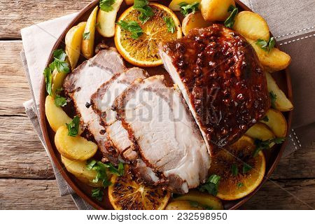 Fried Pork Tenderloin With Potatoes, Oranges And Apples Close-up. Horizontal Top View From Above