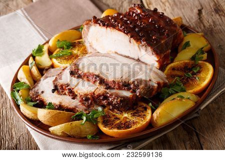 Christmas Baked Ham Chopped Sliceswith Potatoes, Oranges And Apples Close-up. Horizontal
