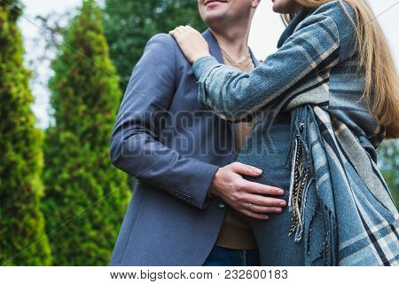 Man And Pregnant Woman On A Green Background