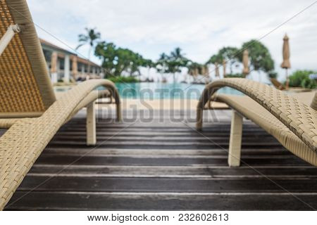 Sun Chairs Or Loungers At The Swimming Pool. Place For Ideal Rest