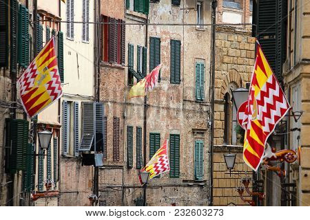 Siena, Italy. Old Town Is Divided Into Traditional Districts (contrade) With Distinct Flags And Colo