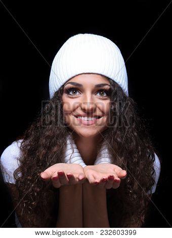 beautiful winter girl isolated on black background