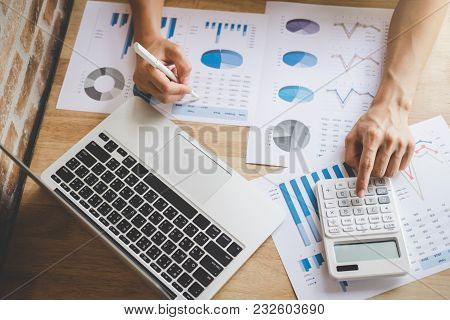 Young Male Working Analysis Finance With Calculate About Cost On Investment, Planning Data On Docume