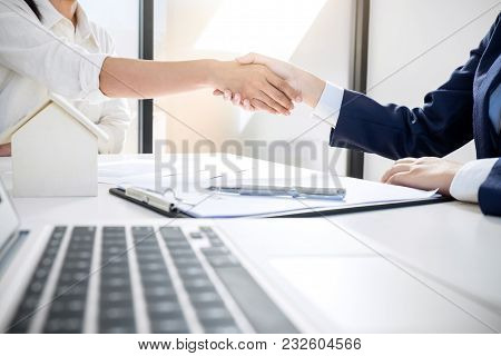 Handshake After Good Cooperation, Real Estate Broker Residential Agent Shaking Hands With Customer A