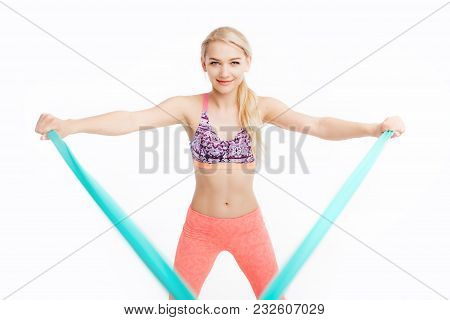 Fit Young Pretty Woman Exercises With Stretch Bands