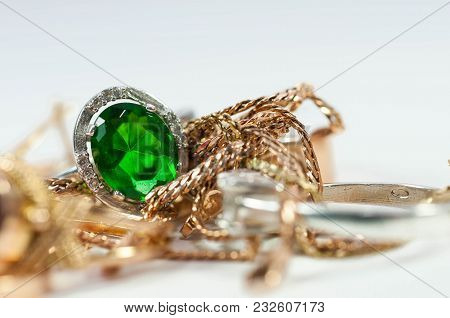 Silver Ring With Green Gem  , Golden Chain And Rings Isolated On White Background.