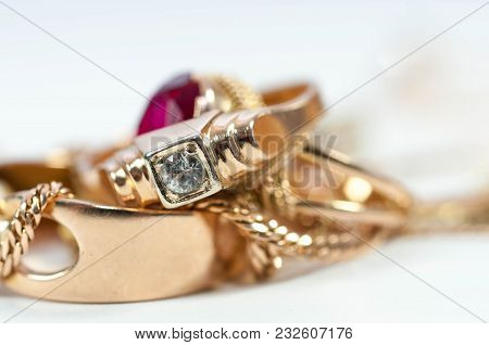 Real Gold Rings With Diamond , Gold Chain Isolated On White Background.