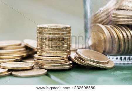 Money Savings And Success Concept - Gold Coins Close-up