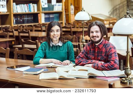 Two Students Studying In Reading Hall, Indoor Shot In Library Facilities