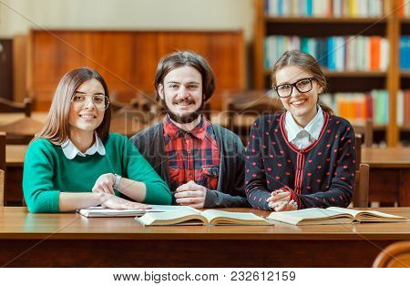 Group Of Students Studying In The Library, Indoor Shot In College