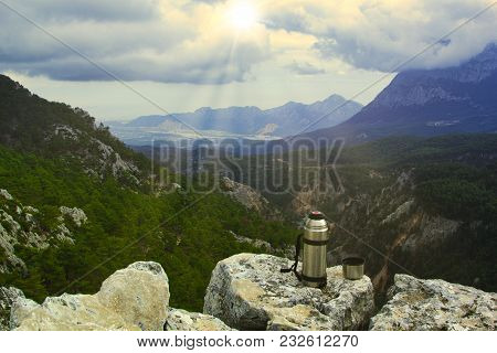 Vintage Camera On Rock And Coffee Cup In The Morning With Mountain View Background