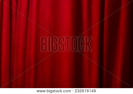 Red Curtains Background. Closed Curtains. Textured Background
