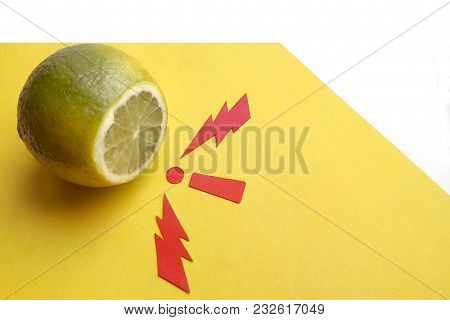 Lime Fruit On Yellow And White Background Red Zipper Paper Signs And Exclamation Point