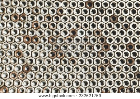 Background Of Metal Mounting Nuts. Close Up.