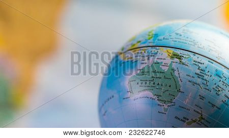 Australia Map On A Globe With Earth Map In The Background