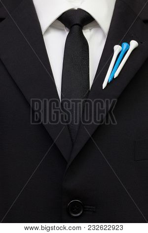 The Detail Of Wedding Suit With Golf Design.golf Tees In The Color Of Finland  Flag On The Flap Of B