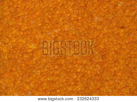 Orange Silica Gel Desiccant Beads Abstract Background