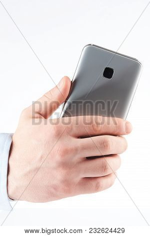 Back View Of Smartphone In Hand With Camera Isolated On White Background