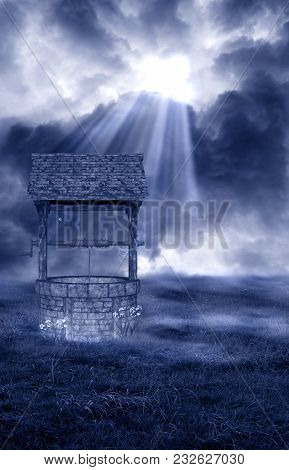 A Wishing Well Background Wiht A Ray Of Light Shining Down On It.