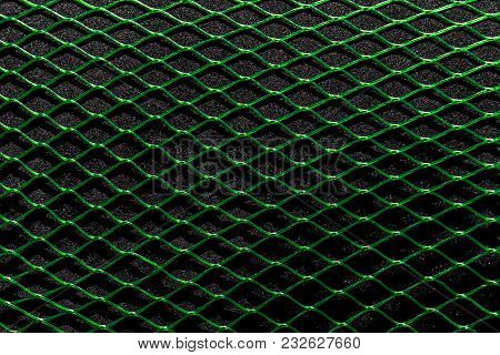 Green Horizontal Net On The Black Soft Background Surface