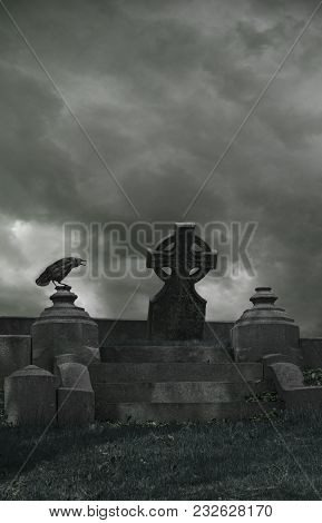 A Background Of A Gothic Cemetery With A Crow And Celtic Cross.