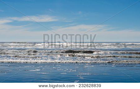 Ocean Beach Waves Splashing Onto Sea Shoreline. Beautiful Scene Of Natures Sea And Skies.