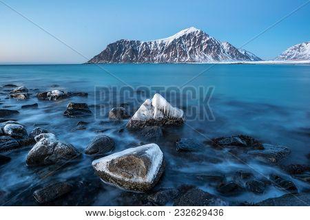Frozen Rocks On Skagsanden Beach In Lofoten Norway